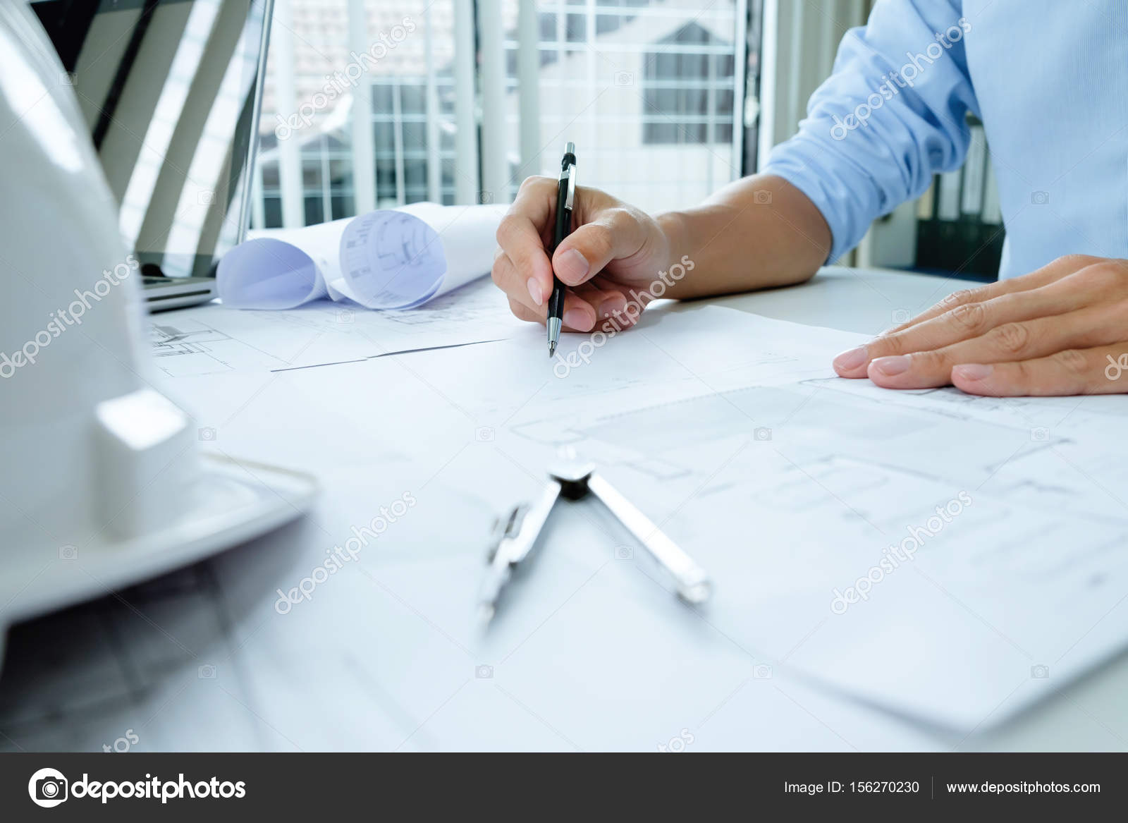 depositphotos 156270230 stock photo engineer meeting for architectural project - Contacts